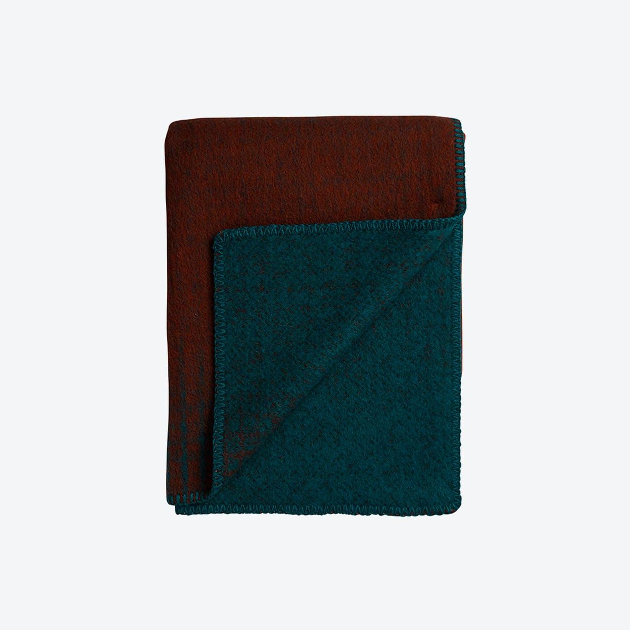 Bernadette Lambswool Throw in Rust/Turquoise