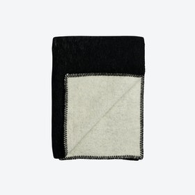 Color Noise Lambswool Throw in Black/Natural