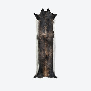 Super Long Stretched Faux Cowhide Rug in Natural