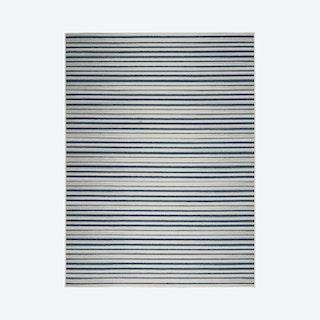 Calobra Area Rug - Ivory / Grey
