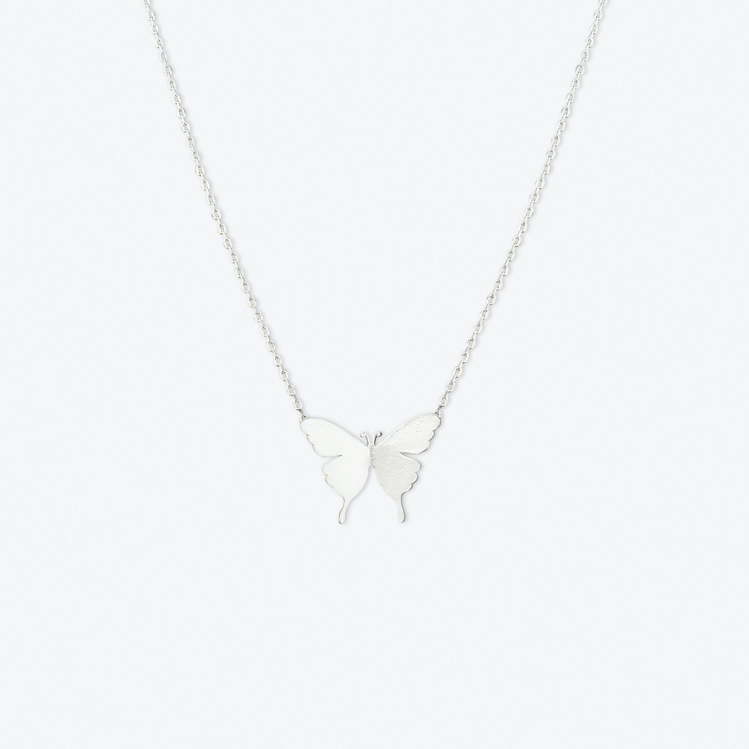 Delicate Butterfly Pendant Necklace In White Gold
