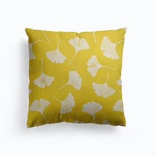 Ginkgo Biloba Leaves On Yellow Background Canvas Cushion