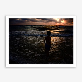 Young Boy Looking At The Sunset Print