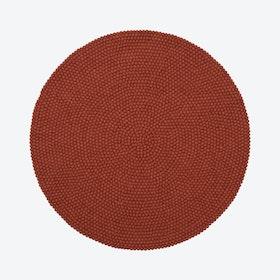 Round Lora Felt Ball Rug in Rusty Red