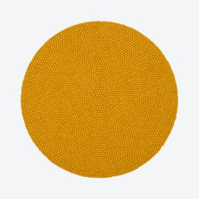 Round Klara Felt Ball Rug in Mustard Yellow