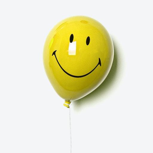 Ceramic Balloon Smile Wall Decor in Yellow