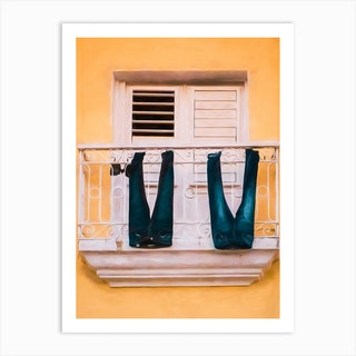 Jeans Drying From A Balcony Art Print