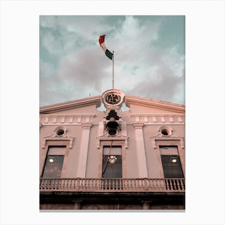 Mexican Farcade And Flag In Merida Canvas Print