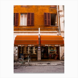 Red Shop And Bike In Ferrara Italy Canvas Print