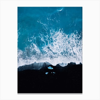Black Sand Beach In Iceland With Waves And Ice Canvas Print