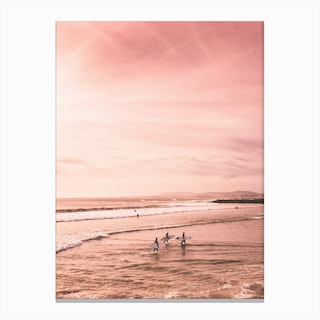 Surfers In Pink Beach Canvas Print