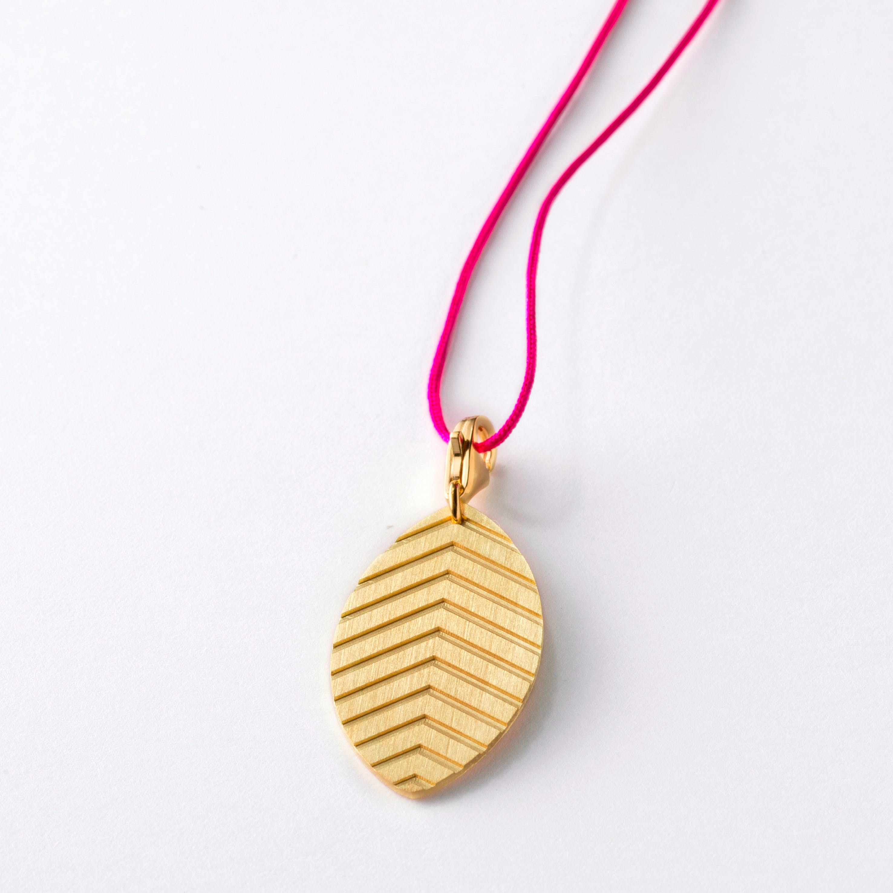 Little Leaf Tabacco Gold Pendant on Raspberry Lace