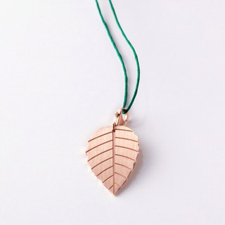 Little Leaf Angels Trumpet Rose Gold Pendant on Fir Tree Green Lace