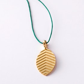 Little Leaf Tabacco Gold Pendant on Fir Tree Green Lace